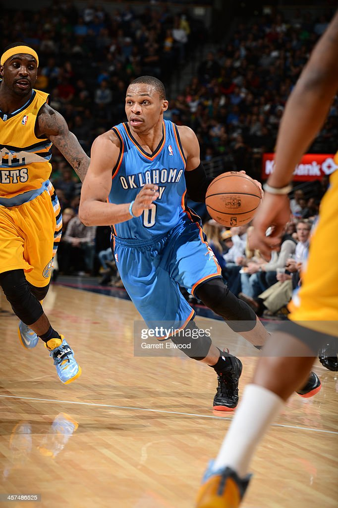 <a gi-track='captionPersonalityLinkClicked' href=/galleries/search?phrase=Russell+Westbrook&family=editorial&specificpeople=4044231 ng-click='$event.stopPropagation()'>Russell Westbrook</a> #0 of the Oklahoma City Thunder drives to the basket against the Denver Nuggets on December 17, 2013 at the Pepsi Center in Denver, Colorado.