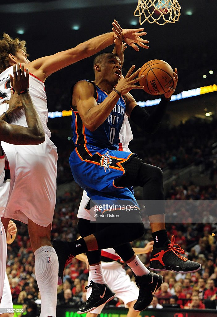 Russell Westbrook of the Oklahoma City Thunder drives to the basket on Robin Lopez of the Portland Trail Blazers during the second quarter of the...
