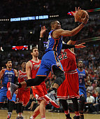 Russell Westbrook of the Oklahoma City Thunder drives to the basket past Pau Gasol and Taj Gibson of the Chicago Bulls at the United Center on...