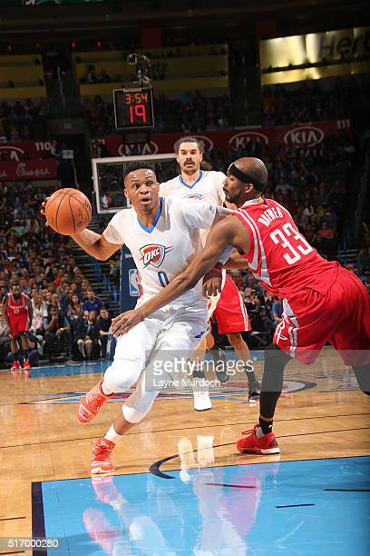 Russell Westbrook of the Oklahoma City Thunder drives to the basket against Corey Brewer of the Houston Rockets on March 22 2016 at Chesapeake Energy...