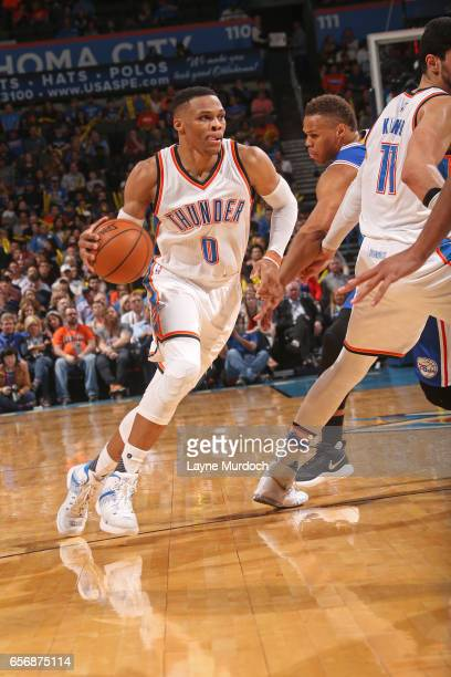Russell Westbrook of the Oklahoma City Thunder drives to the basket en route to the first ever perfect triple double in NBA history during the game...