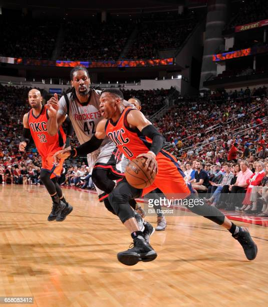 Russell Westbrook of the Oklahoma City Thunder drives to the basket against the Houston Rockets during the game on March 26 2017 at the Toyota Center...
