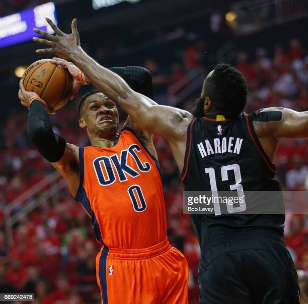 Russell Westbrook of the Oklahoma City Thunder drives to the basket as James Harden of the Houston Rockets defends during Game One of the first round...