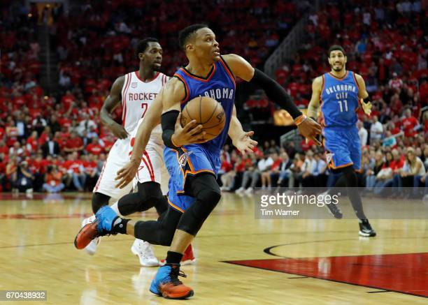 Russell Westbrook of the Oklahoma City Thunder drives to the basket defended by Eric Gordon of the Houston Rockets in the second half of Game Two of...
