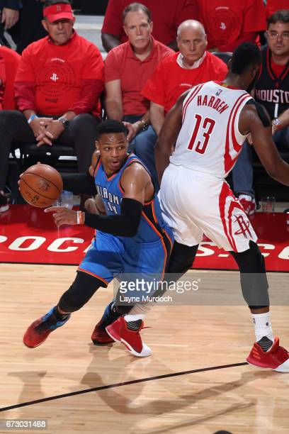 Russell Westbrook of the Oklahoma City Thunder drives to the basket during the game against James Harden of the Houston Rockets in Game Five of the...
