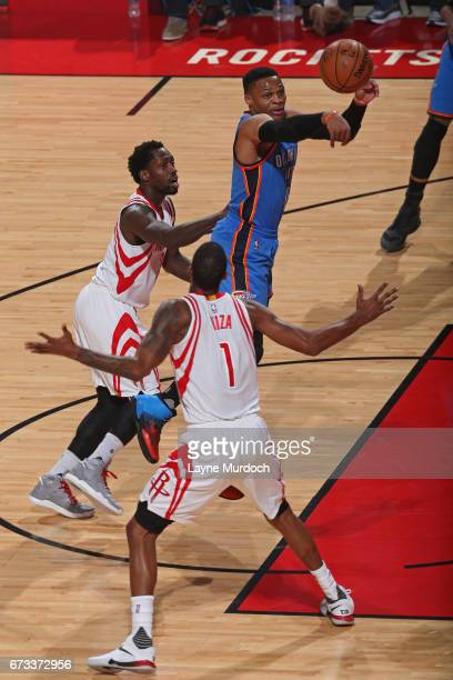 Russell Westbrook of the Oklahoma City Thunder drives to the basket and passes the ball against the Houston Rockets in Game Five of the Western...