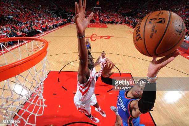 Russell Westbrook of the Oklahoma City Thunder drives to the basket around Clint Capela of the Houston Rockets in Game Five of the Western Conference...