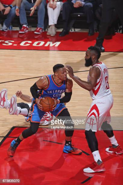 Russell Westbrook of the Oklahoma City Thunder drives to the basket while guarded by James Harden of the Houston Rockets during Game Five of the...