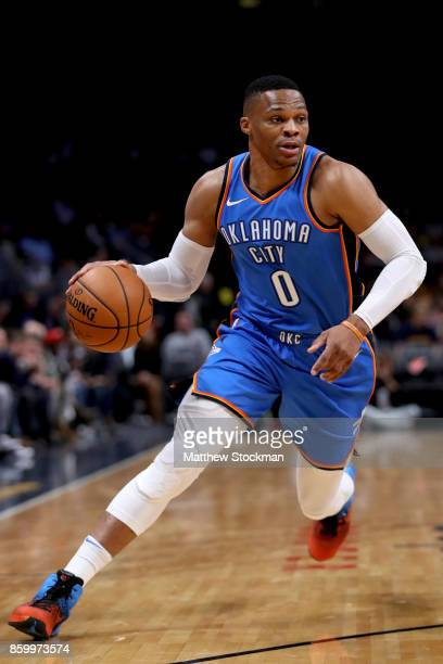 Russell Westbrook of the Oklahoma City Thunder drives to the basket against the Denver Nuggets at the Pepsi Center on October 10 2017 in Denver...