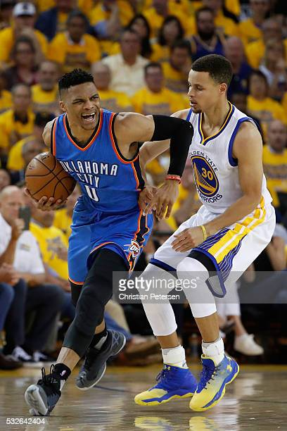 Russell Westbrook of the Oklahoma City Thunder drives with the ball against Stephen Curry of the Golden State Warriors during game two of the Western...