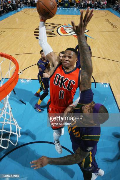 Russell Westbrook of the Oklahoma City Thunder dunks against DeMarcus Cousins of the New Orleans Pelicans on February 26 2017 at the Chesapeake...