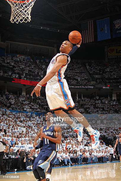 Russell Westbrook of the Oklahoma City Thunder dunks against Mike Conley of the Memphis Grizzlies in Game Five of the Western Conference Semifinals...