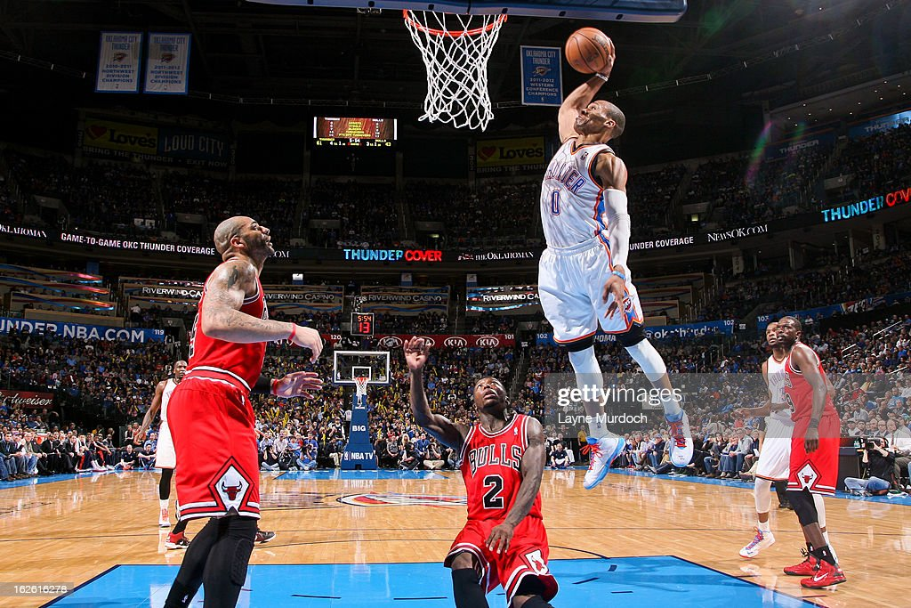 <a gi-track='captionPersonalityLinkClicked' href=/galleries/search?phrase=Russell+Westbrook&family=editorial&specificpeople=4044231 ng-click='$event.stopPropagation()'>Russell Westbrook</a> #0 of the Oklahoma City Thunder dunks against <a gi-track='captionPersonalityLinkClicked' href=/galleries/search?phrase=Nate+Robinson&family=editorial&specificpeople=208906 ng-click='$event.stopPropagation()'>Nate Robinson</a> #2 of the Chicago Bulls on February 24, 2013 at the Chesapeake Energy Arena in Oklahoma City, Oklahoma.