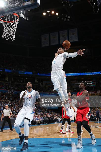 Russell Westbrook of the Oklahoma City Thunder dunks against the New Orleans Pelicans on February 11 2016 at the Chesapeake Energy Arena in Oklahoma...