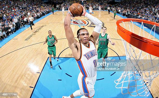 Russell Westbrook of the Oklahoma City Thunder dunks against the Boston Celtics on March 18 2015 at the Chesapeake Energy Arena in Oklahoma City...