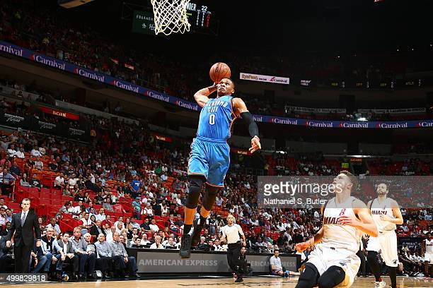 Russell Westbrook of the Oklahoma City Thunder dunks against the Miami Heat on December 3 2015 at AmericanAirlines Arena in Miami Florida NOTE TO...