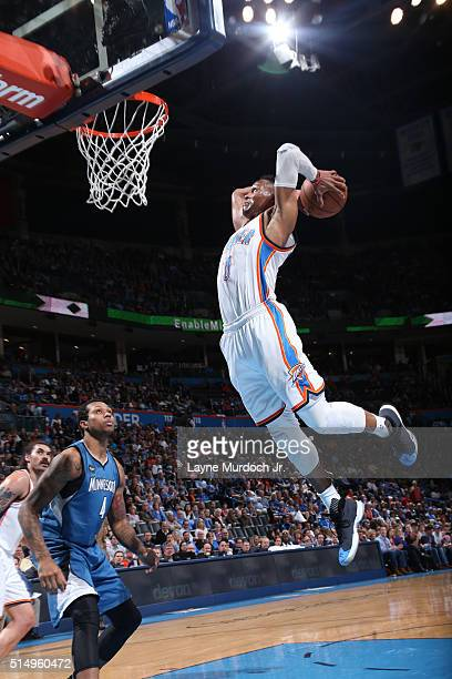 Russell Westbrook of the Oklahoma City Thunder dunks against the Minnesota Timberwolves on March 10 2016 at the Chesapeake Energy Arena in Oklahoma...