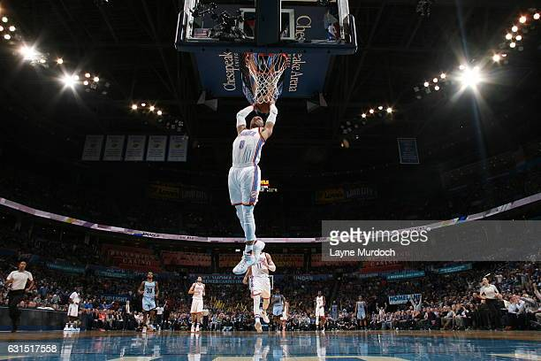 Russell Westbrook of the Oklahoma City Thunder dunks against the Memphis Grizzlies on January 11 2017 at the Chesapeake Energy Arena in Oklahoma City...