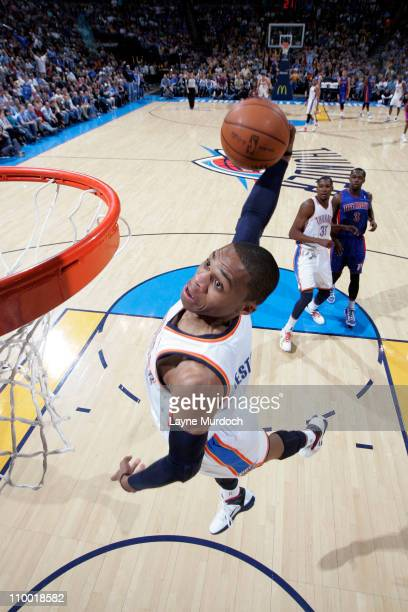 Russell Westbrook of the Oklahoma City Thunder dunks against the Detroit Pistons during the game on March 11 2011 at the Oklahoma City Arena in...