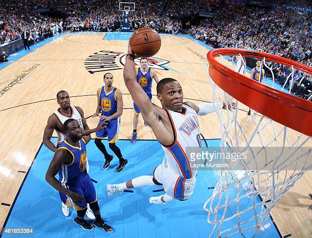 Russell Westbrook of the Oklahoma City Thunder dunks against the Golden State Warriors on January 16 2015 at Chesapeake Energy Arena in Oklahoma City...