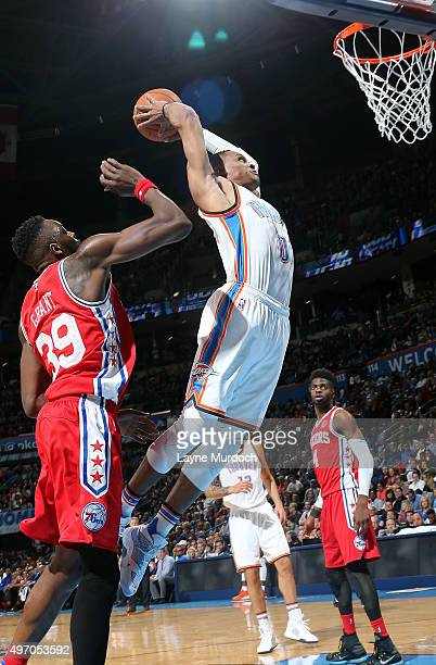 Russell Westbrook of the Oklahoma City Thunder dunks against the Philadelphia 76ers during the game on November 13 2015 at Chesapeake Energy Arena in...
