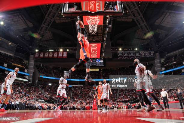Russell Westbrook of the Oklahoma City Thunder dunks against the Houston Rockets during the game on March 26 2017 at the Toyota Center in Houston...