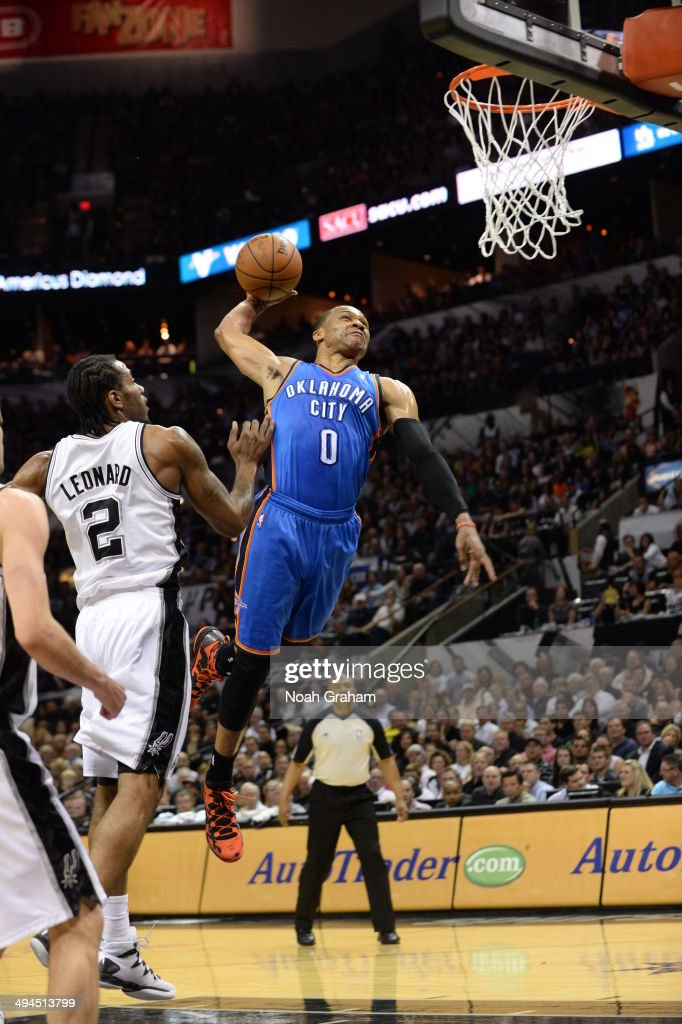 Russell Westbrook #0 of the Oklahoma City Thunder dunks against the San Antonio Spurs in Game Five of the Western Conference Finals during the 2014 NBA Playoffs on May 29, 2014 at the AT&T Center in San Antonio, Texas.