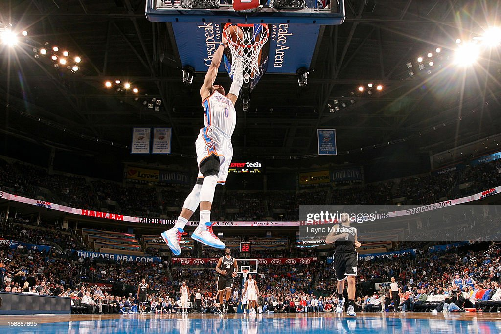 Russell Westbrook #0 of the Oklahoma City Thunder dunks on a fast break against the Brooklyn Nets on January 2, 2013 at the Chesapeake Energy Arena in Oklahoma City, Oklahoma.
