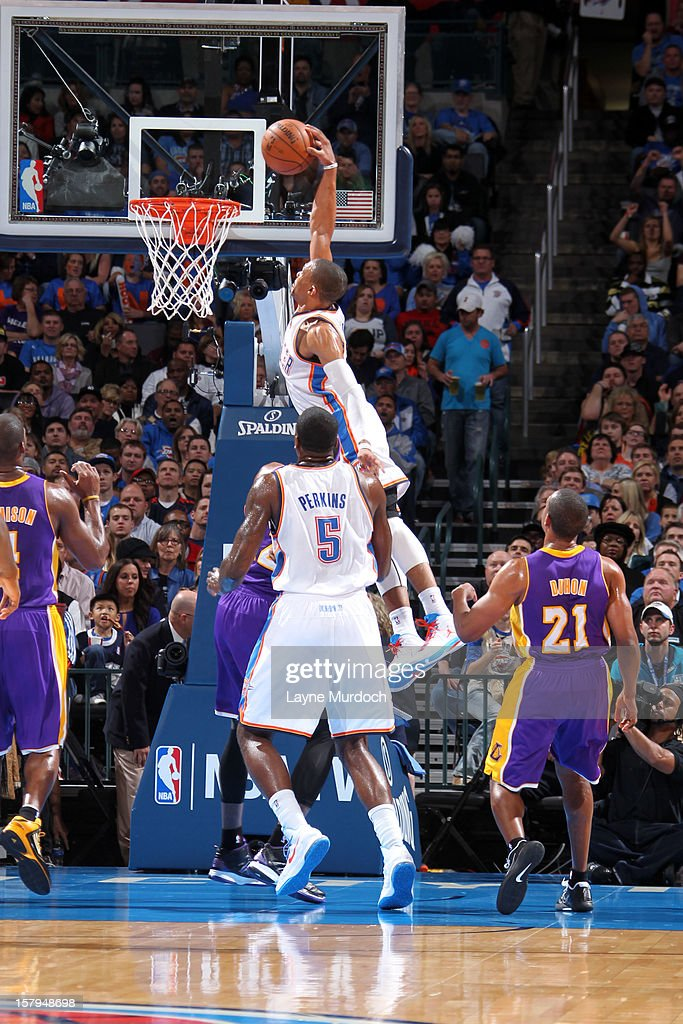Russell Westbrook #0 of the Oklahoma City Thunder dunks the ball against the Los Angeles Lakers during an NBA game on December 7, 2012 at the Chesapeake Energy Arena in Oklahoma City, Oklahoma.