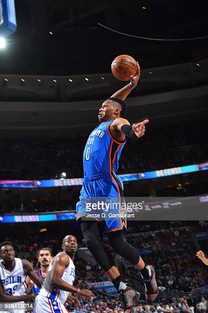 Russell Westbrook of the Oklahoma City Thunder dunks the ball against the Philadelphia 76ers at Wells Fargo Center on March 18 2016 in Philadelphia...