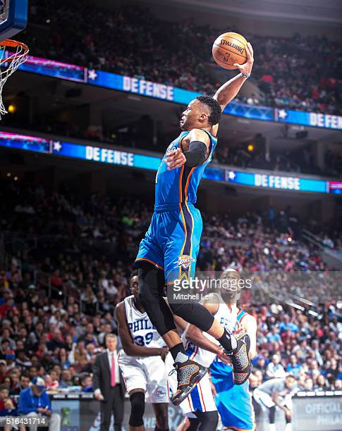 Russell Westbrook of the Oklahoma City Thunder dunks the ball against the Philadelphia 76ers on March 18 2016 at the Wells Fargo Center in...