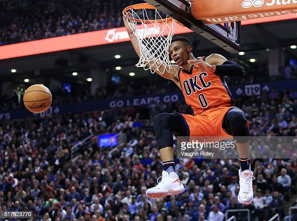 Russell Westbrook of the Oklahoma City Thunder dunks the ball during the first half of an NBA game against the Toronto Raptors at the Air Canada...