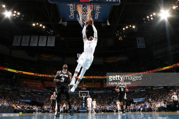 Russell Westbrook of the Oklahoma City Thunder dunks the ball during the game against the San Antonio Spurs on March 9 2017 at Chesapeake Energy...