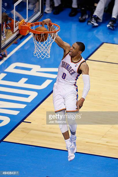 Russell Westbrook of the Oklahoma City Thunder dunks the ball in the first half against the San Antonio Spurs during Game Four of the Western...