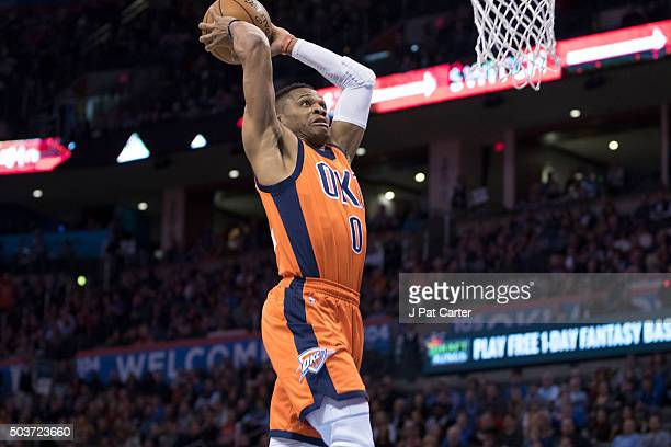 Russell Westbrook of the Oklahoma City Thunder dunks two points against the Memphis Grizzlies during the first quarter of a NBA game at the...