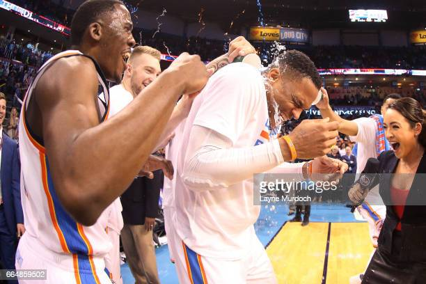 Russell Westbrook of the Oklahoma City Thunder gets water poured on him by his teammates after the game where he tied Oscar Robinson for most...