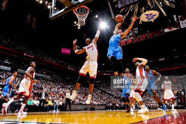 Russell Westbrook of the Oklahoma City Thunder goes for a dunk against Chris Bosh of the Miami Heat in Game Four of the 2012 NBA Finals at American...