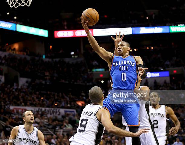 Russell Westbrook of the Oklahoma City Thunder goes for a shot against Tony Parker of the San Antonio Spurs in the third quarter in Game One of the...