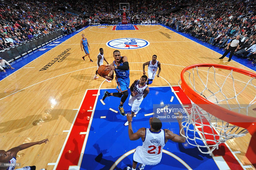 Russell Westbrook #0 of the Oklahoma City Thunder goes for the bucket against the Philadelphia 76ers during the game at the Wells Fargo Center on November 24, 2012 in Philadelphia, Pennsylvania.