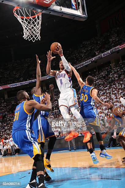 Russell Westbrook of the Oklahoma City Thunder goes for the layup during the game tate Warriors in Game Four of the Western Conference Finals during...