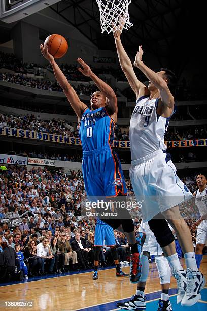 Russell Westbrook of the Oklahoma City Thunder goes in for the layup against Yi Jianlian of the Dallas Mavericks on February 1 2012 at the American...