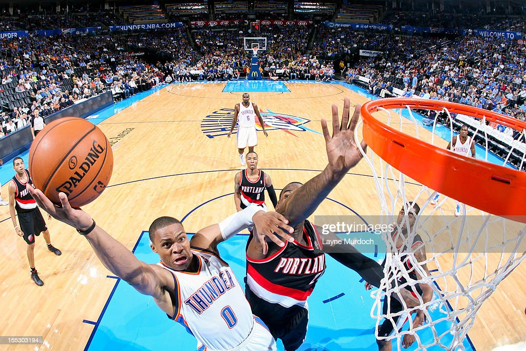 <a gi-track='captionPersonalityLinkClicked' href=/galleries/search?phrase=Russell+Westbrook&family=editorial&specificpeople=4044231 ng-click='$event.stopPropagation()'>Russell Westbrook</a> #0 of the Oklahoma City Thunder goes to the basket against <a gi-track='captionPersonalityLinkClicked' href=/galleries/search?phrase=J.J.+Hickson&family=editorial&specificpeople=4226173 ng-click='$event.stopPropagation()'>J.J. Hickson</a> #21 of the Portland Trail Blazers on November 2, 2012 at the Chesapeake Energy Arena in Oklahoma City, Oklahoma.