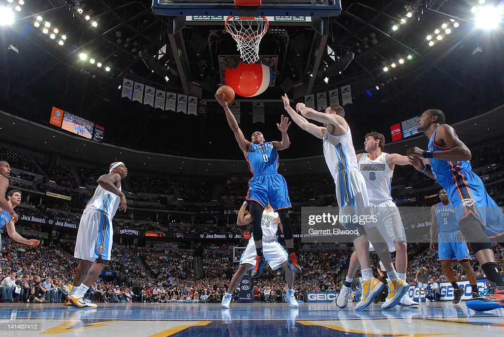 <a gi-track='captionPersonalityLinkClicked' href=/galleries/search?phrase=Russell+Westbrook&family=editorial&specificpeople=4044231 ng-click='$event.stopPropagation()'>Russell Westbrook</a> #0 of the Oklahoma City Thunder goes to the basket against the Denver Nuggets on March 15, 2012 at the Pepsi Center in Denver, Colorado.