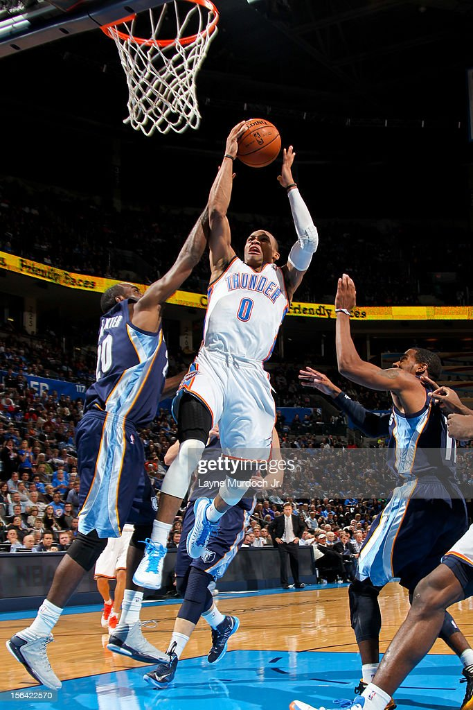 <a gi-track='captionPersonalityLinkClicked' href=/galleries/search?phrase=Russell+Westbrook&family=editorial&specificpeople=4044231 ng-click='$event.stopPropagation()'>Russell Westbrook</a> #0 of the Oklahoma City Thunder goes to the basket against <a gi-track='captionPersonalityLinkClicked' href=/galleries/search?phrase=Quincy+Pondexter&family=editorial&specificpeople=4176540 ng-click='$event.stopPropagation()'>Quincy Pondexter</a> #20 of the Memphis Grizzlies on November 14, 2012 at the Chesapeake Energy Arena in Oklahoma City, Oklahoma.