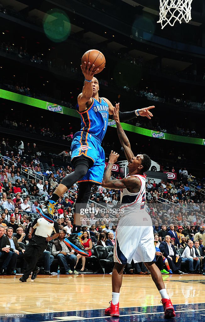 <a gi-track='captionPersonalityLinkClicked' href=/galleries/search?phrase=Russell+Westbrook&family=editorial&specificpeople=4044231 ng-click='$event.stopPropagation()'>Russell Westbrook</a> #0 of the Oklahoma City Thunder goes to the basket against <a gi-track='captionPersonalityLinkClicked' href=/galleries/search?phrase=Louis+Williams&family=editorial&specificpeople=670315 ng-click='$event.stopPropagation()'>Louis Williams</a> #3 of the Atlanta Hawks during the game between the Atlanta Hawks and the Oklahoma City Thunder at Philips Arena on December 19, 2012 in Atlanta, Georgia.