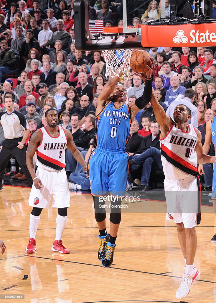 Russell Westbrook #0 of the Oklahoma City Thunder goes to the basket against Nicolas Batum #88 of the Portland Trail Blazers on January 13, 2013 at the Rose Garden Arena in Portland, Oregon.