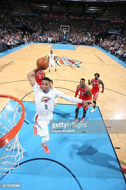 Russell Westbrook of the Oklahoma City Thunder goes to the basket against the Houston Rockets on March 22 2016 at Chesapeake Energy Arena in Oklahoma...