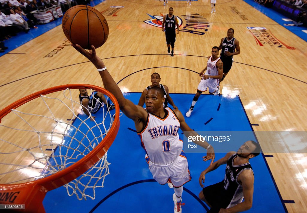 <a gi-track='captionPersonalityLinkClicked' href=/galleries/search?phrase=Russell+Westbrook&family=editorial&specificpeople=4044231 ng-click='$event.stopPropagation()'>Russell Westbrook</a> #0 of the Oklahoma City Thunder goes to the hoop against Manu Ginobili #20 of the San Antonio Spurs in Game Six of the Western Conference Finals of the 2012 NBA Playoffs at Chesapeake Energy Arena on June 6, 2012 in Oklahoma City, Oklahoma.