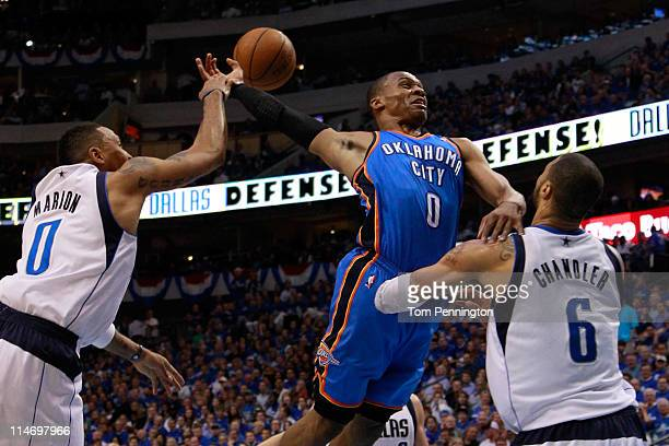 Russell Westbrook of the Oklahoma City Thunder goes up for a dunk as Shawn Marion of the Dallas Mavericks attempts to block the dunk as Westbrook...