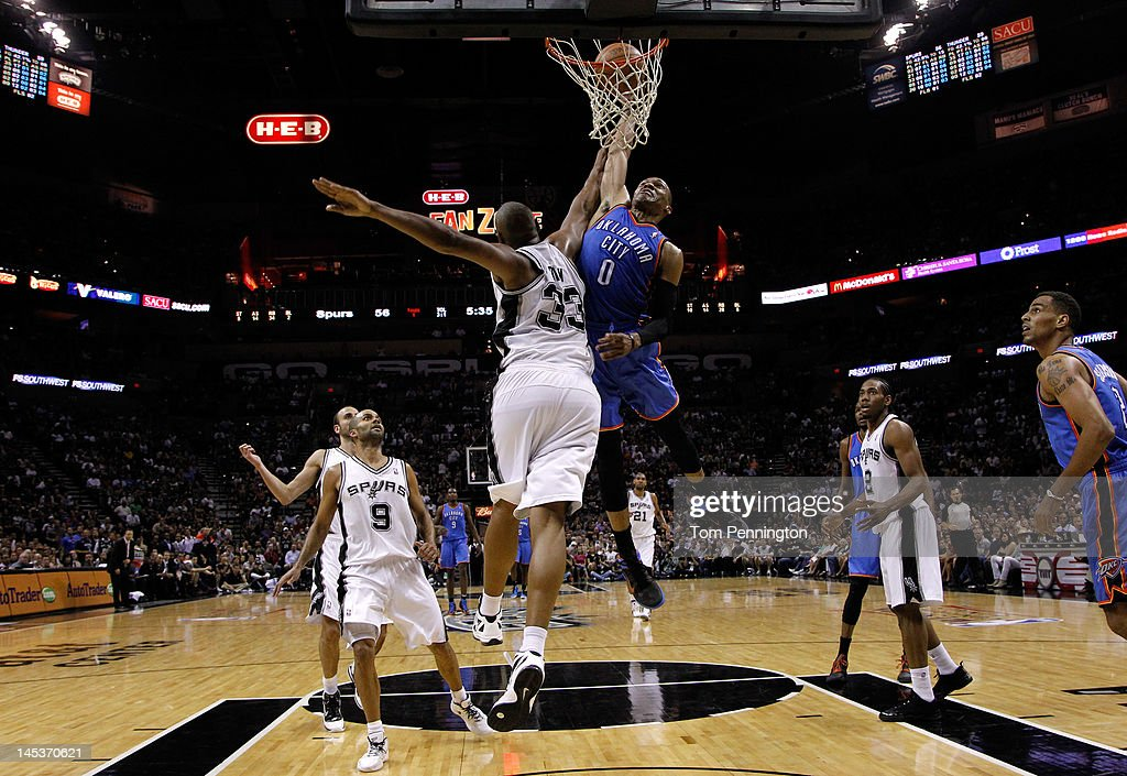 Russell Westbrook #0 of the Oklahoma City Thunder goes up for a dunk over Boris Diaw #33 of the San Antonio Spurs in the second half in Game One of the Western Conference Finals of the 2012 NBA Playoffs at AT&T Center on May 27, 2012 in San Antonio, Texas.
